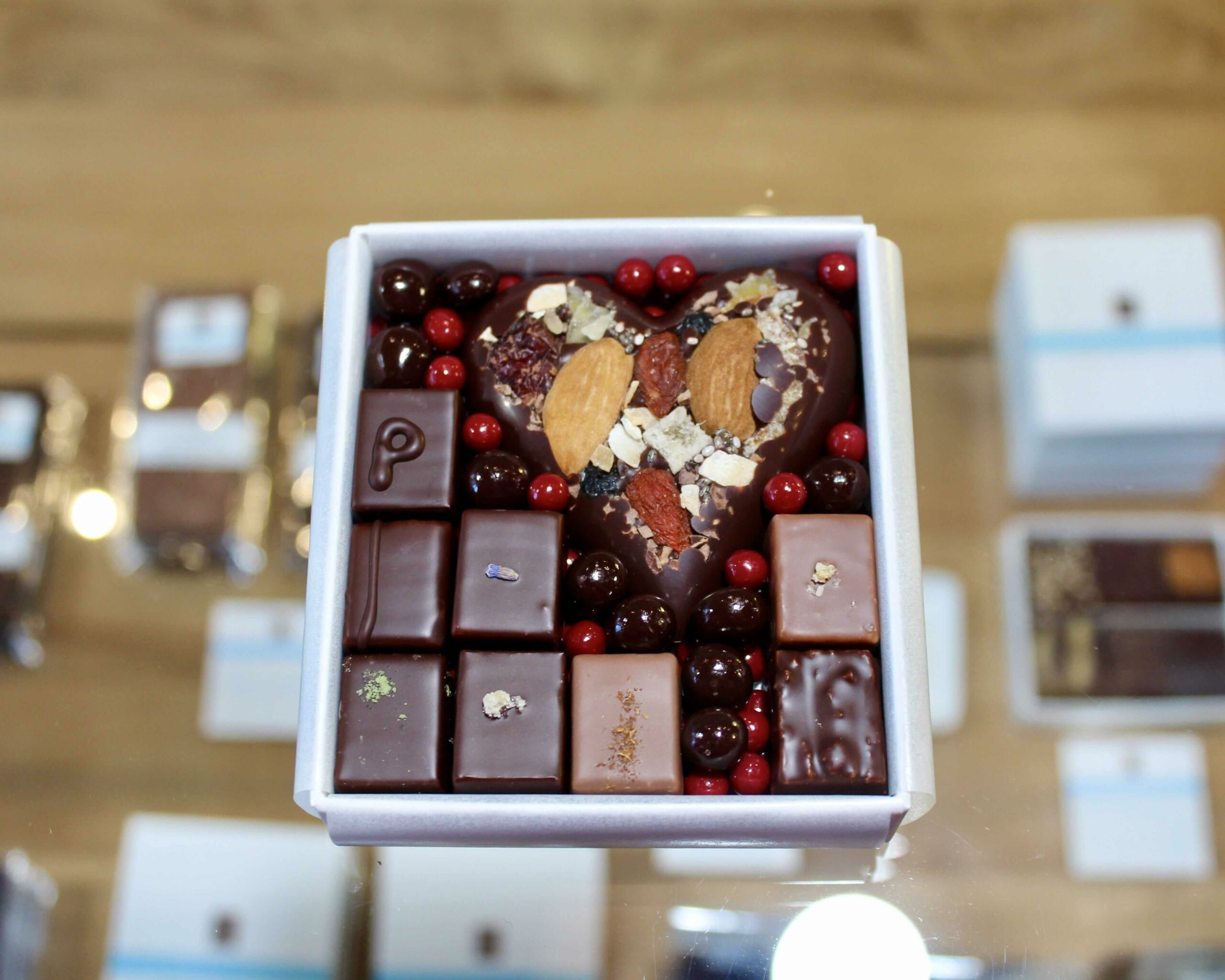 hilde devolder chocolatier box with chocolates and chocolaty nutty fruity heart
